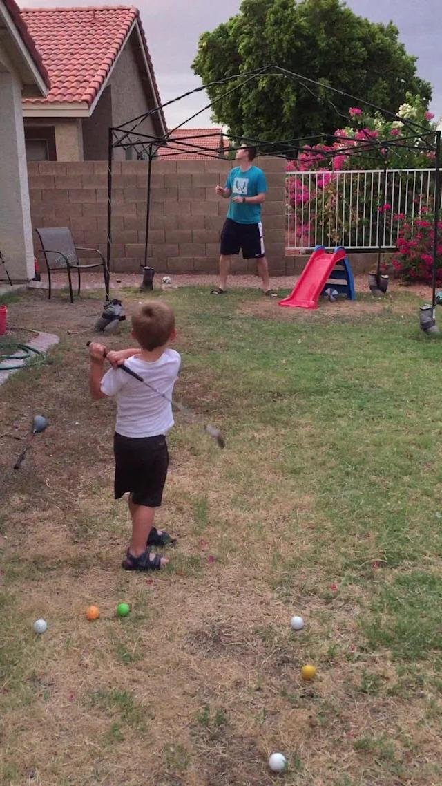 "If you have the talents, then the job is half done. Not everybody gets that much luck in their life. Once you have, hold onto it and improve on it. A two-year-old boy from Glendale, Arizona can easily become the new Tiger Woods. Owen Earl has been swinging a <a href=""https://rumble.com/v3ewbp-que-grande-fufu-que-grande-fufu-que-grande-fufu.html"" rel=""nofollow noopener"" target=""_blank"" data-ylk=""slk:golf club"" class=""link rapid-noclick-resp"">golf club</a> since he started to walk, and if this video is any proof, t looks like it will pay off big time for him! He and his dad, Brad Earl, were playing some golf in their backyard in Arizona. Mom saw it as a good chance to filming her son while playing the game and make it a good memory for the years that follow. First the little boy swung right into his father's arms. Then he tries a second time. It goes too low. A bet the starting point was on the wrong place. Then comes the third try. It was a nice swing, daddy got the ball. Now comes the important one… or not. The next one is this boy's finest swing. Aaaaand we have a winner. What a swing! It went so high that it ended right into the neighbor's yard. So small, but with that much strength in him. At his age, he is much better that most adults. A real golf prodigy. I would say he is destined for big things. Just keep on practicing kiddo. When you grow up, you will become a real <a href=""https://rumble.com/v354or-golf-ball-sized-hail-in-brazil.html"" rel=""nofollow noopener"" target=""_blank"" data-ylk=""slk:golf"" class=""link rapid-noclick-resp"">golf</a> champion. Credit to @owensgolfvideos"