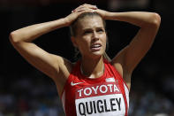 """FILE - United States' Colleen Quigley looks at her time from heat two of the women's 3000m steeplechase at the World Athletics Championships at the Bird's Nest stadium in Beijing, in this Monday, Aug. 24, 2015, file photo. Quigley left Nike after what they've described as discriminatory or insulting business practices. """"Nike was trying to offer me less than what they offered me when I came out of college,"""" Quigley said in a recent podcast. """"To me, it was just a slap in the face."""" (AP Photo/David J. Phillip)"""
