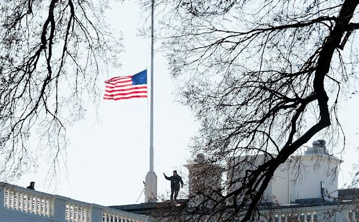 The US flag flies at half-staff on the White House in Washington on March 7, 2016 in honor of late former first lady Nancy Reagan (AFP Photo/Nicholas Kamm)