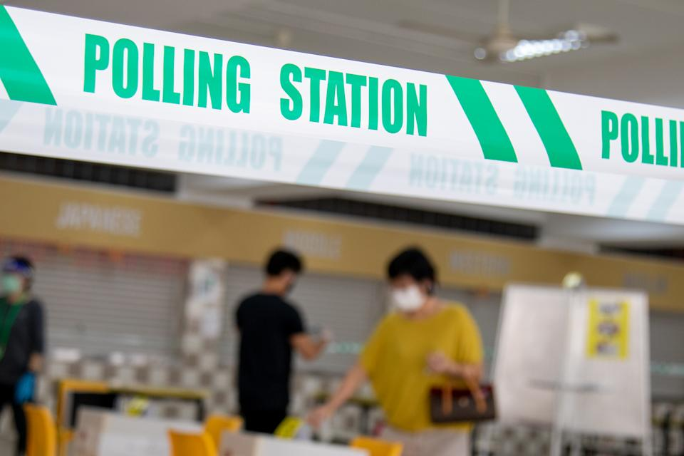 People seen voting at Chung Cheng High School on 10 July. (PHOTO: Dhany Osman / Yahoo News Singapore)