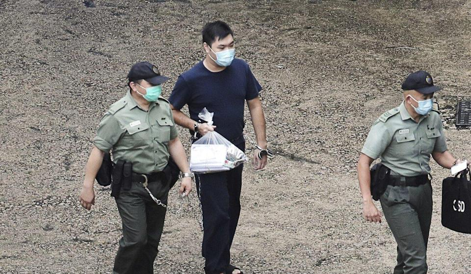 Tong Ying-kit, 24, is taken from his prison cell to a court hearing in August. Photo: Handout