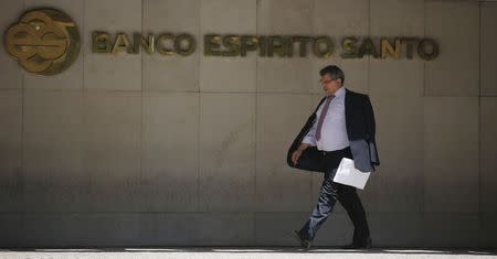A man leaves the headquarters of Portuguese bank Banco Espirito Santo (BES) in Lisbon
