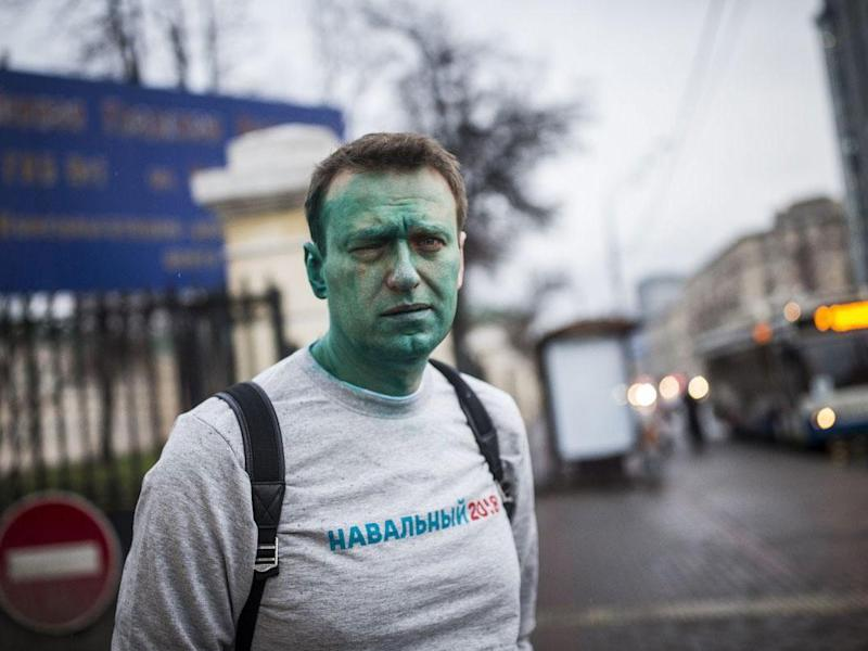 Russian opposition figure Alexei Navalny was attacked by an assailant wielding a green chemical and suffered severe damage to his eye: Evgeny Feldman/Pool Photo via AP