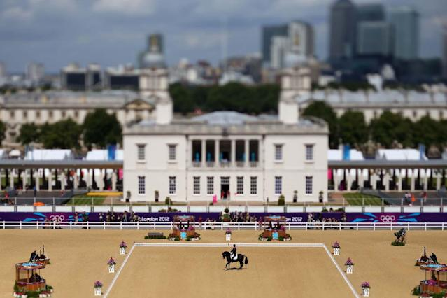 LONDON, ENGLAND - AUGUST 02: (EDITORS NOTE: Image was created using a variable planed lens.) Carl Hester of Great Britain riding Uthopia competes in the Dressage Grand Prix on Day 6 of the London 2012 Olympic Games at Greenwich Park on August 2, 2012 in London, England. (Photo by Alex Livesey/Getty Images)