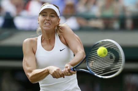 Maria Sharapova of Russia hits a return to Samantha Murray of Britain in their women's singles tennis match at the Wimbledon Tennis Championships, in London June 24, 2014. REUTERS/Stefan Wermuth