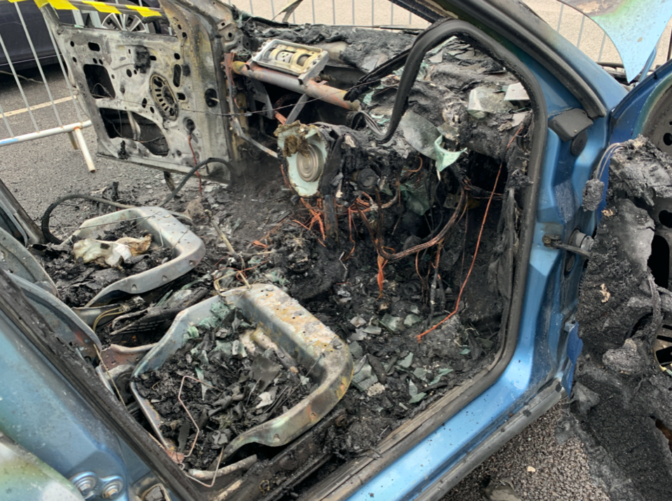 The car was left in ruins after it burst into flames. (SWNS)