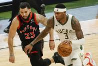 Milwaukee Bucks' Torrey Craig tries to get past Toronto Raptors' Fred VanVleet during the second half of an NBA basketball game Tuesday, Feb. 16, 2021, in Milwaukee. (AP Photo/Morry Gash)