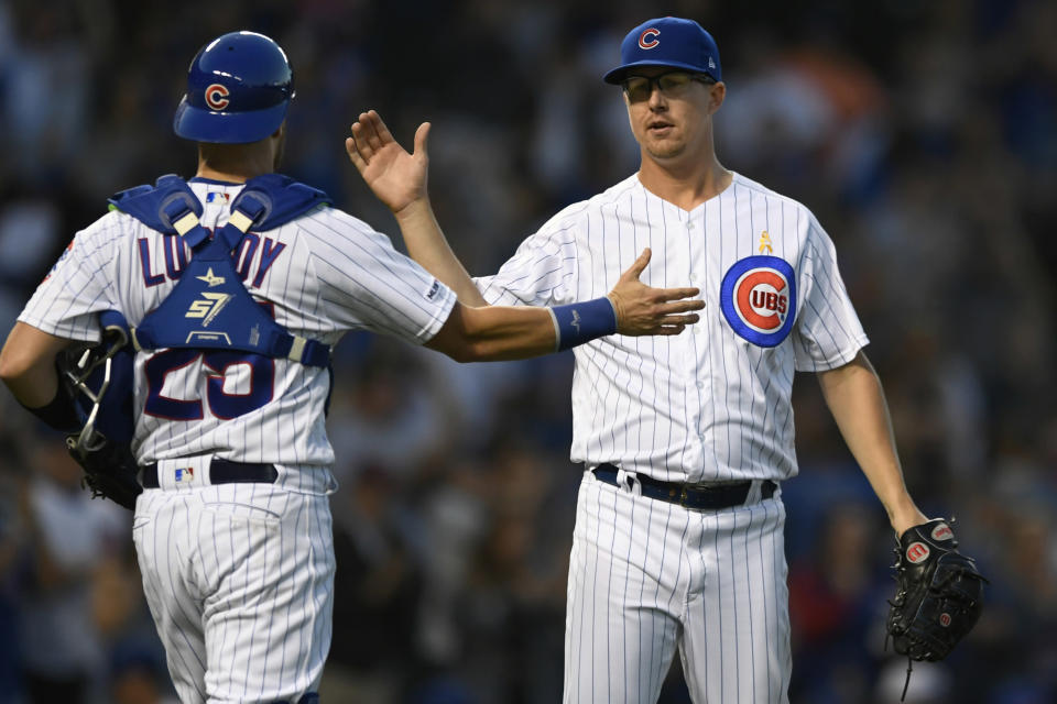Chicago Cubs closing pitcher Alec Mills right, celebrates with catcher Jonathan Lucroy (25) after defeating the Pittsburgh Pirates in a baseball game Friday, Sept. 13, 2019, in Chicago. (AP Photo/Paul Beaty)