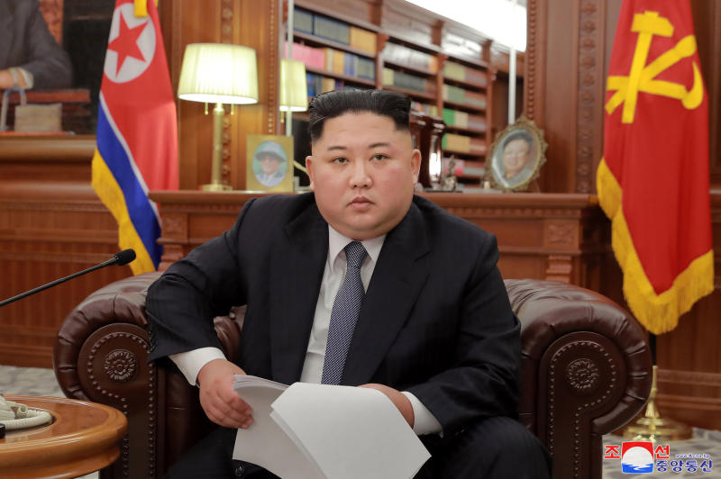 """FILE - In this file photo released on Jan. 1, 2019, North Korean leader Kim Jong Un delivers a New Year's speech in North Korea. While President Donald Trump waits in the wings, North Korean leader Kim Jong Un arrived in Beijing on Tuesday, Jan. 8, 2019 for his fourth summit with China's Xi Jinping. Kim's four-day visit comes after he expressed frustration in his annual New Year's address over the lack of progress in negotiations with Washington since his unprecedented summit with U.S. President Donald Trump in Singapore seven months ago. Independent journalists were not given access to cover the event depicted in this image distributed by the North Korean government. The content of this image is as provided and cannot be independently verified. Korean language watermark on image as provided by source reads: """"KCNA"""" which is the abbreviation for Korean Central News Agency. (Korean Central News Agency/Korea News Service via AP, File)"""