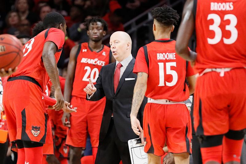 Cincinnati head coach Mick Cronin, center, directs his players in the first half of an NCAA college basketball game against Houston, Sunday, March 10, 2019, in Cincinnati. (AP Photo/John Minchillo)