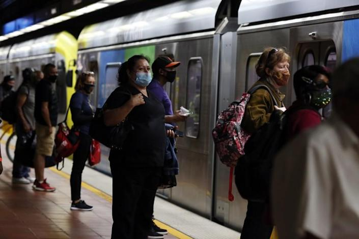 "Transit riders wait for the A Line at the 7th Street/Metro Center station in downtown Los Angeles in July. <span class=""copyright"">(Dania Maxwell / Los Angeles Times)</span>"