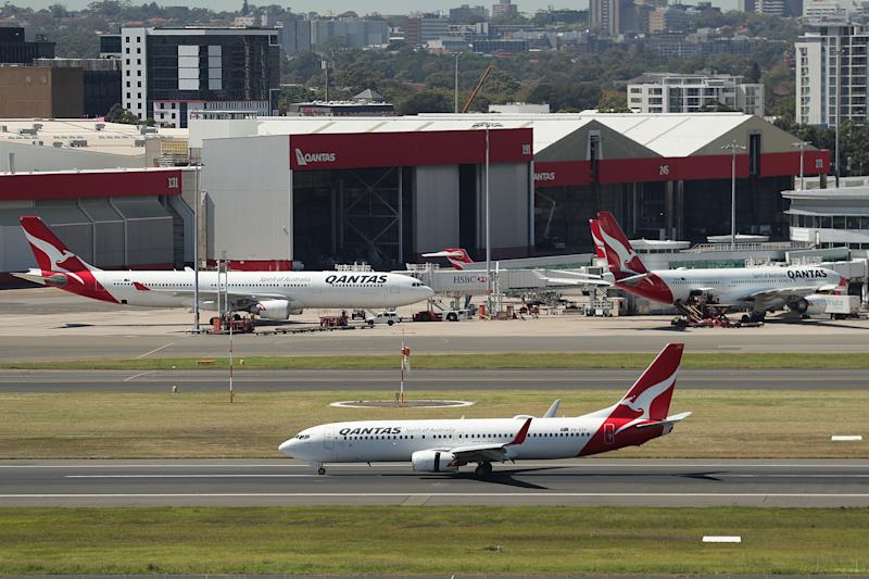 SYDNEY, AUSTRALIA - MARCH 19: A Qantas aircraft prepares to take off the international terminal at Sydney Airport on March 19, 2020 in Sydney, Australia. Qantas has announced it will ground its entire international fleet, including overseas Jetstar flights, from late March following the government's most recent advice for Australians to avoid travel during the COVID-19 pandemic. The airline will also temporarily stand down two-thirds of it's 30,000 staff until May. (Photo by Mark Metcalfe/Getty Images)