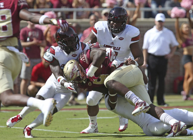 "Florida State's <a class=""link rapid-noclick-resp"" href=""/ncaaf/players/251750/"" data-ylk=""slk:Jacques Patrick"">Jacques Patrick</a> is tackled by a trio of Louisville defenders during an NCAA college football game, Saturday, Oct. 21, 2017, in Tallahassee Fla. Louisville won 31-28. (AP Photo/Steve Cannon)"