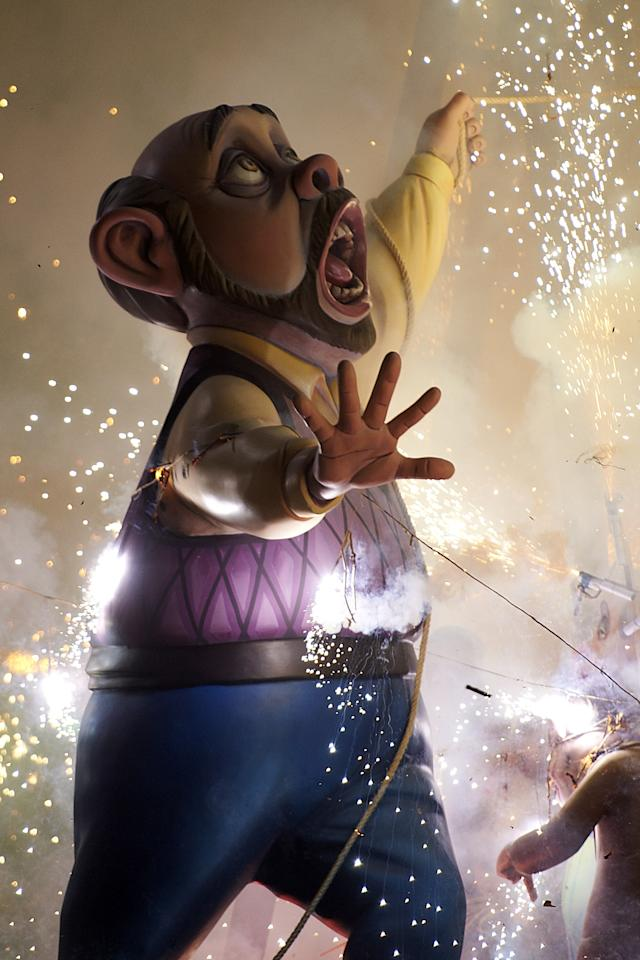 VALENCIA, SPAIN - MARCH 19:  A combustible 'Ninot' caricatures burn during the last day of the 'Fallas' festival on March 19, 2012 in Valencia, Spain.  The festival, which runs March 15 - 19, celebrates the arrival of spring with fireworks, fiestas and bonfires. (Photo by Xaume Olleros/Getty Images)