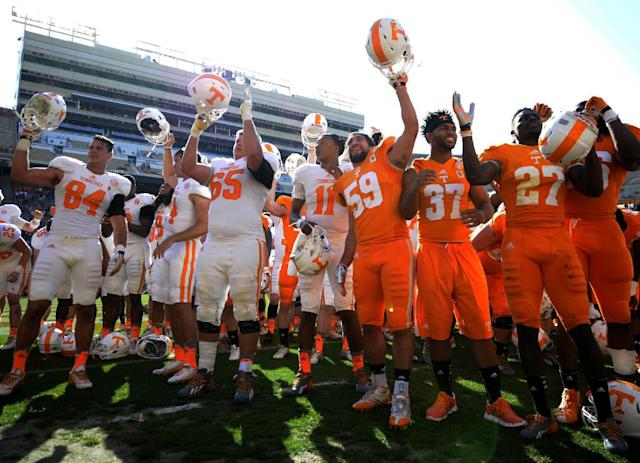 Tennessee football players, including quarter Joshua Dobbs, center, rally on the field at the end of the Orange and White game at Neyland Stadium in Knoxville, Tenn., Saturday, April 12, 2014. (AP Photo/Knoxville News Sentinel, Adam Lau)