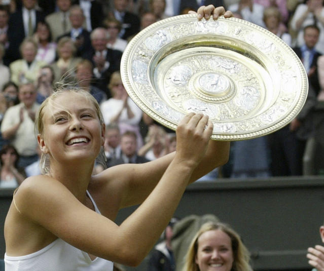 FILE - In this July 3, 2004, file photo, Russia's Maria Sharapova holds the winner's trophy after defeating Serena Williams in the Women's Singles final match on the Centre Court at Wimbledon. Sharapova is retiring from professional tennis at the age of 32 after five Grand Slam titles and time ranked No. 1. She has been dealing with shoulder problems for years. In an essay written for Vanity Fair and Vogue about her decision to walk away from the sport, posted online Wednesday, Feb. 26, 2020, Sharapova asks: How do you leave behind the only life youve ever known? (AP Photo/Anja Niedringhaus, File)