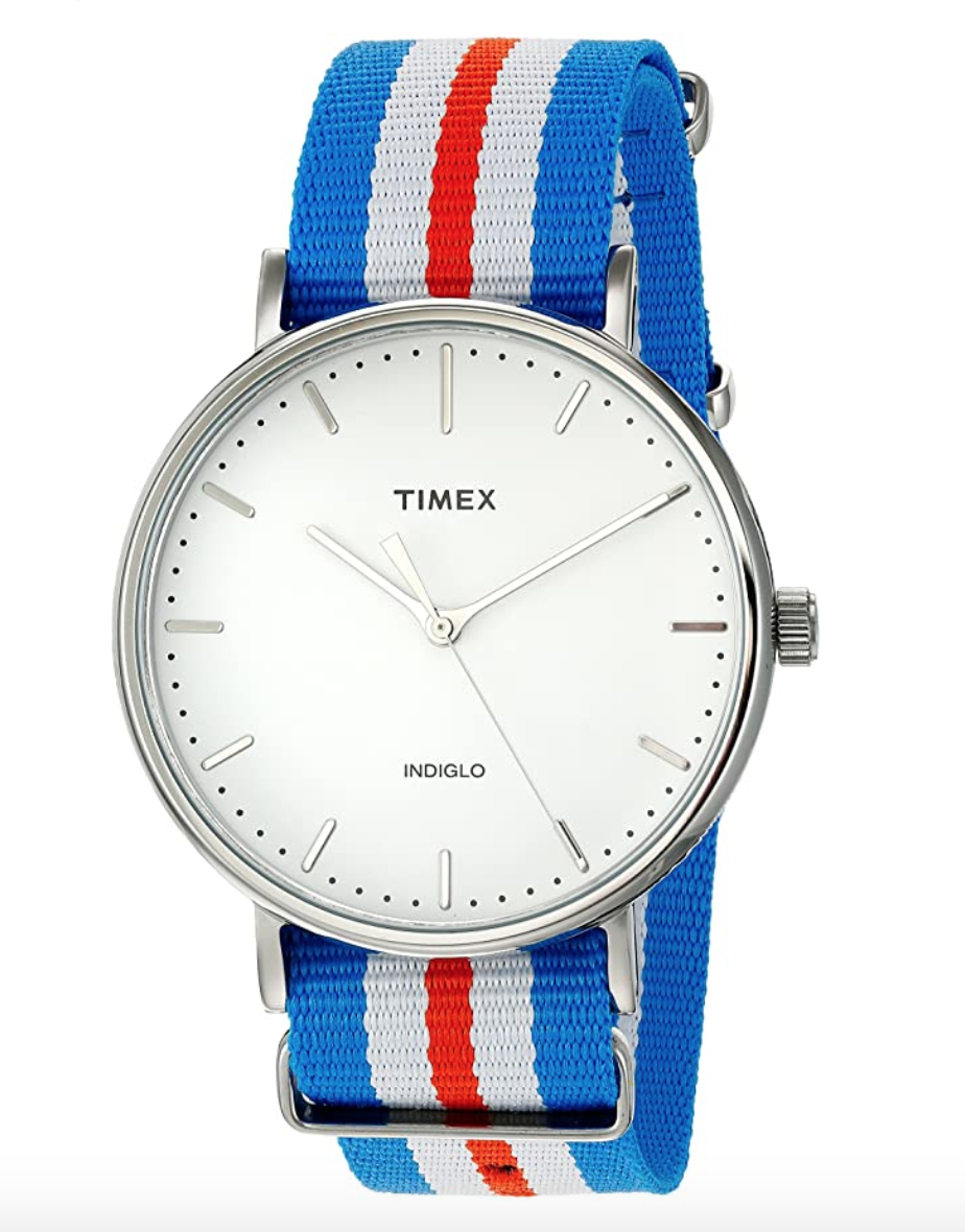 """<p><strong>Timex</strong></p><p>amazon.com</p><p><strong>$43.11</strong></p><p><a href=""""https://www.amazon.com/dp/B0194L6AMC?tag=syn-yahoo-20&ascsubtag=%5Bartid%7C10072.g.26825396%5Bsrc%7Cyahoo-us"""" rel=""""nofollow noopener"""" target=""""_blank"""" data-ylk=""""slk:Shop Now"""" class=""""link rapid-noclick-resp"""">Shop Now</a></p><p>Less is more when it comes to accessorizing. If he's already got a classic black leather strap watch—or something in gold or silver—opt for a less expected red, white, and blue striped band. </p>"""