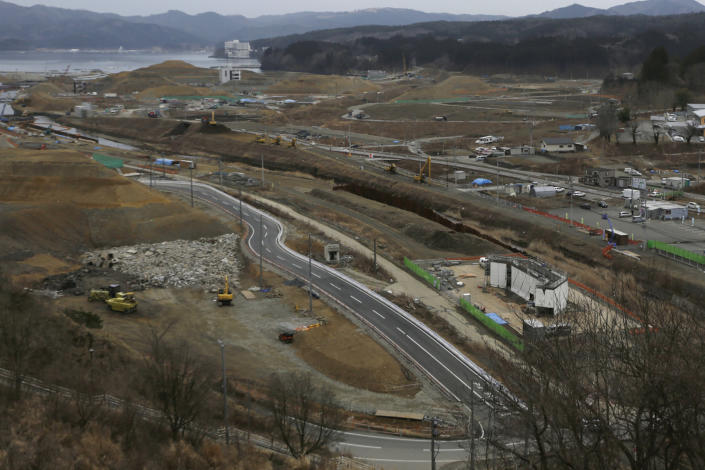 In this March 7, 2016, file photo, construction works go on in the leveled city of Minamisanriku, Miyagi Prefecture, northeastern Japan, almost five years after the March 11, 2011 tsunami. (AP Photo/Eugene Hoshiko, File)