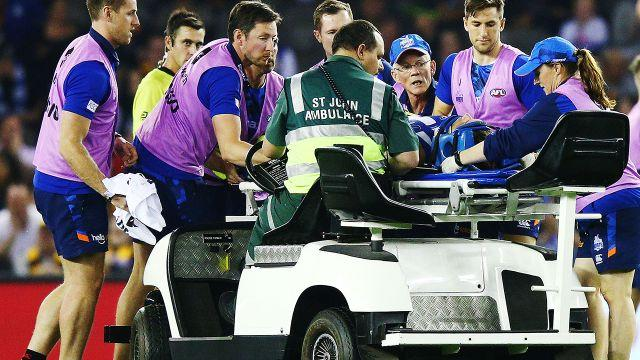 Higgins was taken from the field on a medicab. Image: Getty