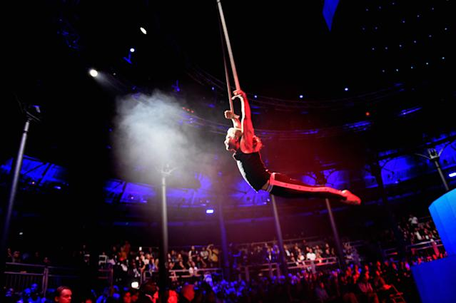 Acrobatic performance during the Tommy x Gigi #TommyNow fashion show in London. (Photo: Getty Images)