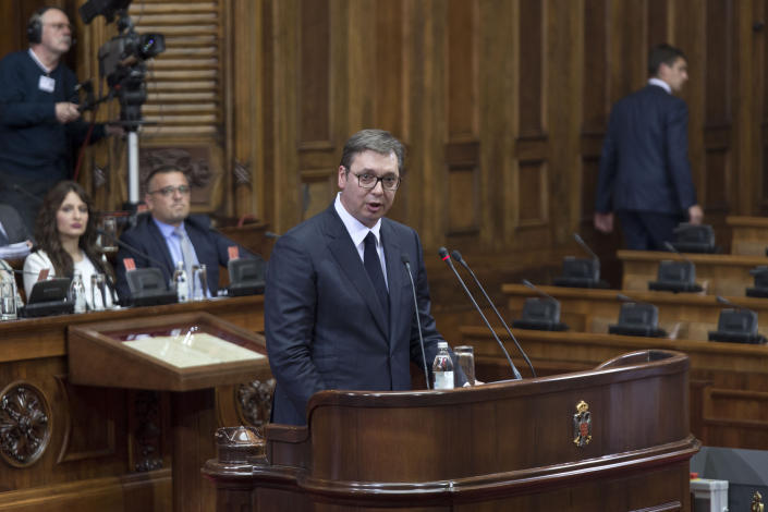 Aleksandar Vucic, the president of Serbia, center, spaks during a session of Serbia's parliament in Belgrade, Serbia Monday, May 27, 2019. Vucic addressed the Serb parlamentarians during a session devoted to the situation in Kosovo, which declared independence from Serbia in 2008. (AP Photo/Marko Drobnjakovic)