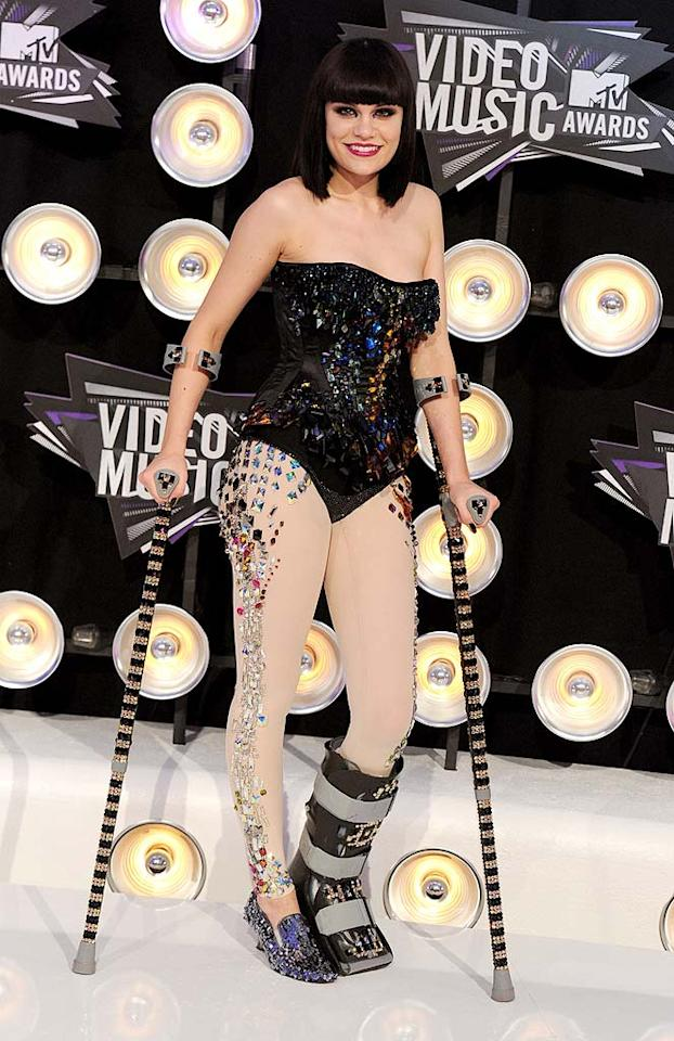"""""""Price Tag"""" songstress Jessie J -- who also fronted the award show's house band -- hobbled into the Nokia Theatre in a bedazzled corset, mirrored leggings, and crystal-adorned crutches. Kevin Mazur/<a href=""""http://www.wireimage.com"""" target=""""new"""">WireImage.com</a> - August 28, 2011"""