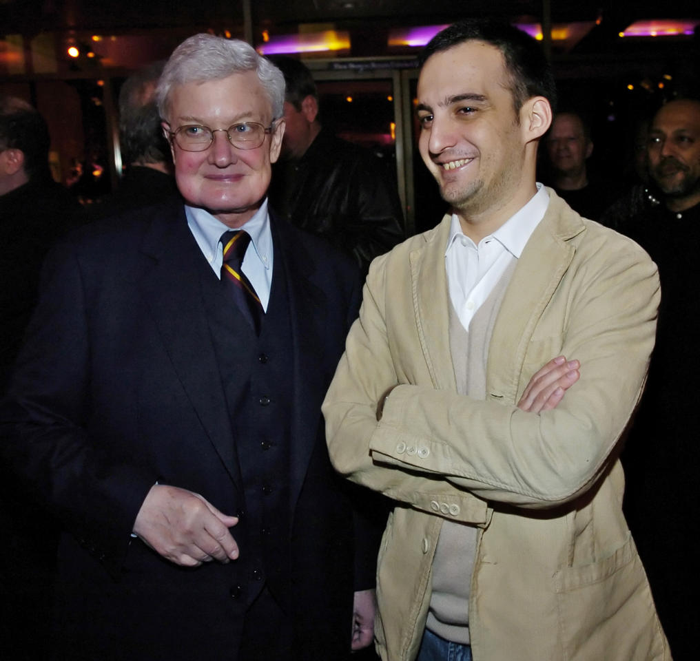 "Film critic Roger Ebert, left, and Alejandro Amenabar of Spain, director of the Oscar-nominated foreign language film ""The Sea Inside,"" pose at a reception for the Best Foreign Language Film nominees, at the Academy of Motion Picture Arts and Sciences in Beverly Hills, Calif, Friday, Feb. 25, 2005. (AP Photo/Chris Pizzello)"