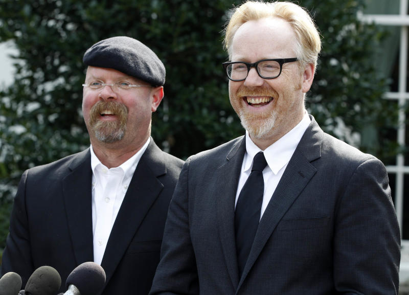 Discovery Channel's MythBusters hosts, Jamie Hyneman, left, and Adam Savage, speak to reporters outside the White House in Washington, Monday, Oct. 18, 2010, after they taped a segment with President Barack Obama.
