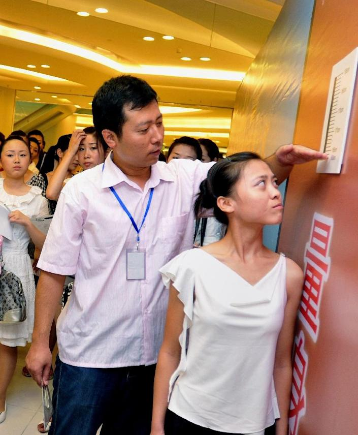 The average Chinese woman is 155.8 centimetres tall, up 0.7 centimetres from 10 years earlier, according to a government report (AFP Photo/AFP)