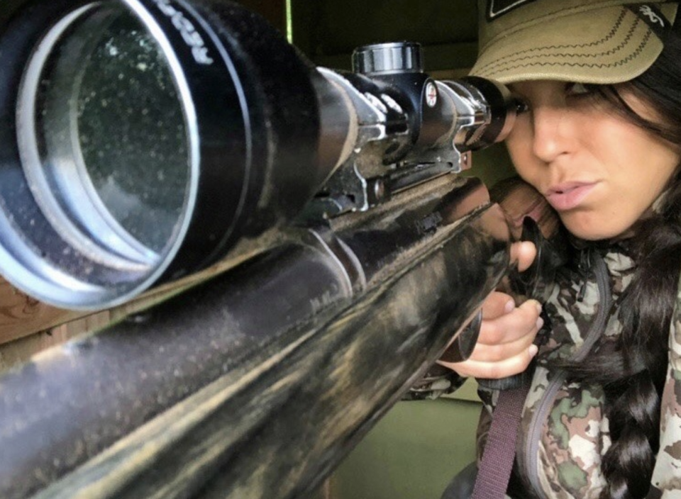 Hunter Kate Small pictured behind a telescopic rifle.