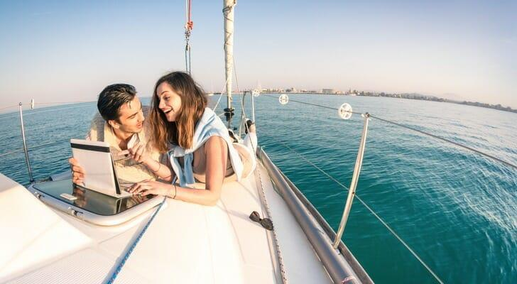 Rich young couple on a sailboat
