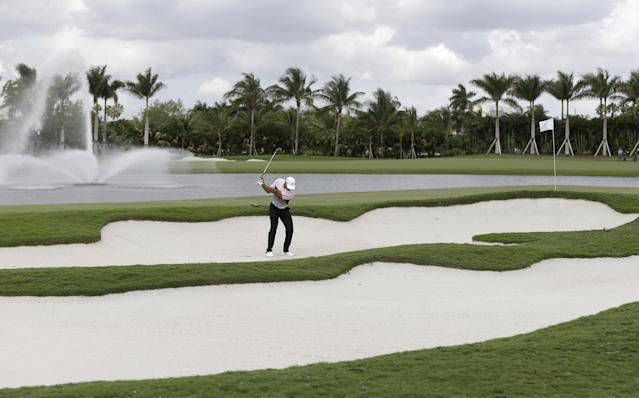 Golfer Tiger Woods hits out of a sand trap on the eighth hole during a practice round of the Cadillac Championship golf tournament, Wednesday, March 5, 2014 in Doral, Fla. (AP Photo/Wilfredo Lee)