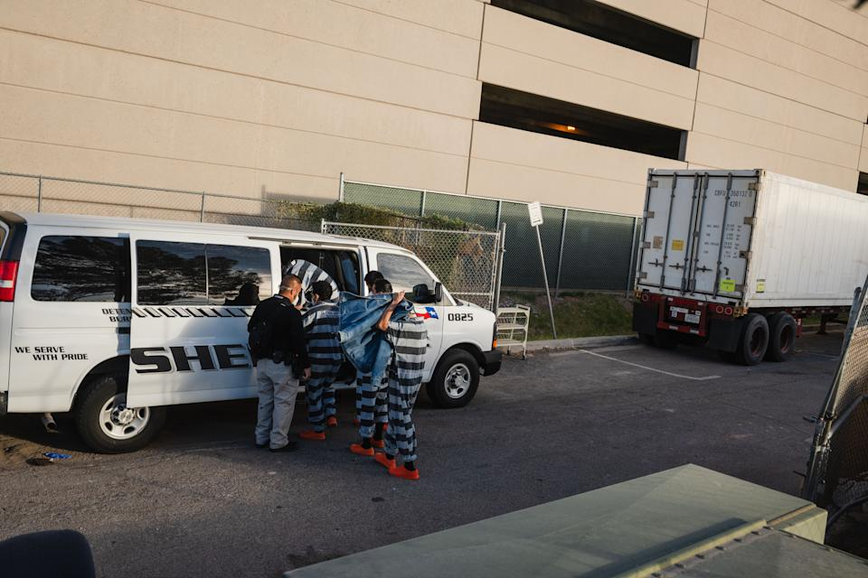 El Paso County detention inmates on work release climb into a transport van after working. Source: Getty