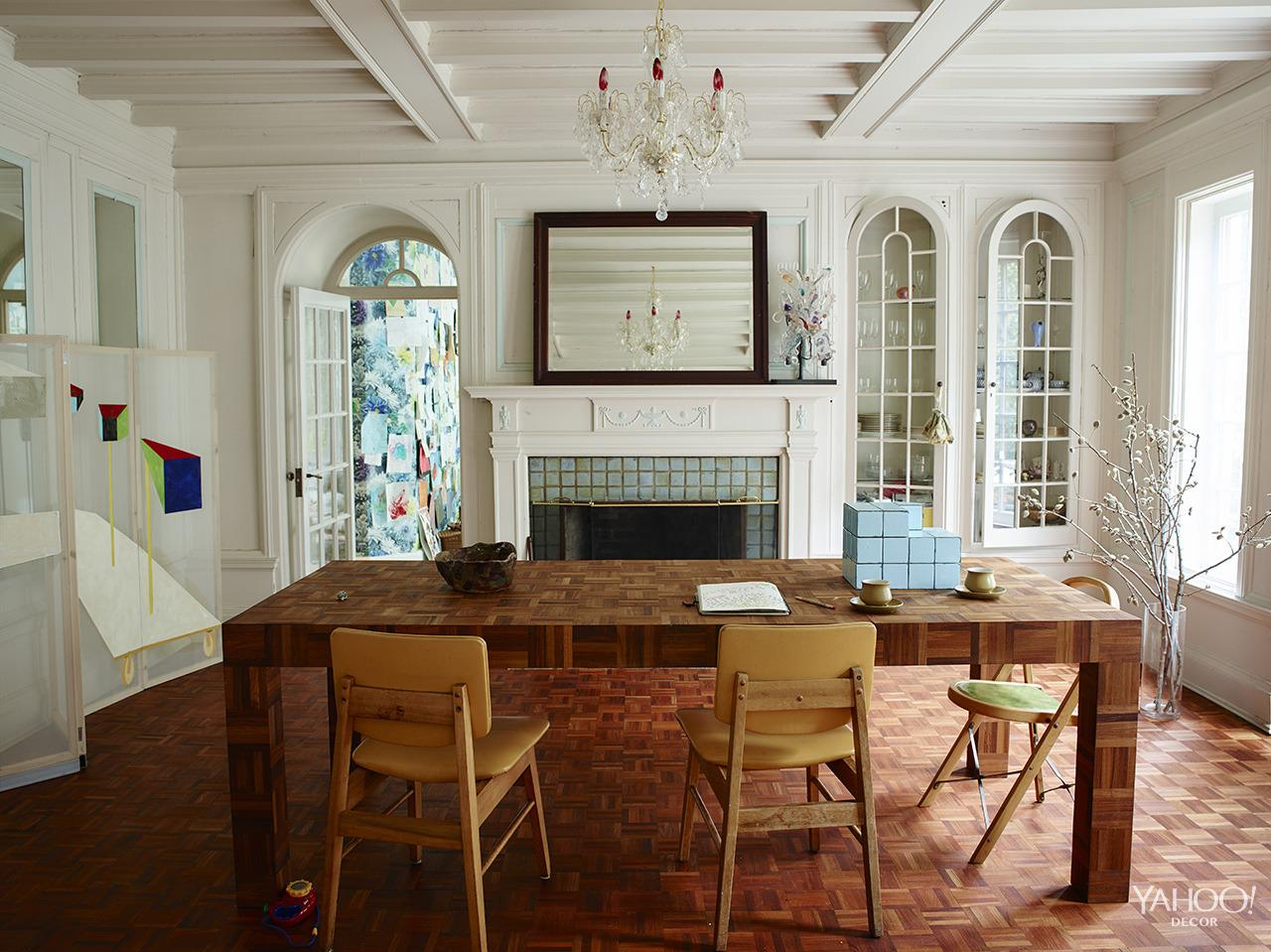"""<p>""""The best part about the dining room is the shapes and angles. I designed this table and our artist friend Gregory Rukavina built it. Sometimes, dining rooms can be dead space, but our family spends a lot of time in here — kids do their homework, it's a great workspace, and we eat here. </p><p>""""To the far left of this picture is a screen that was made by <a href=""""http://voutsa.com/"""">George Venson</a>.George is a friend and very talented wallpaper designer who also makes lighting and screens.""""<br /></p>"""