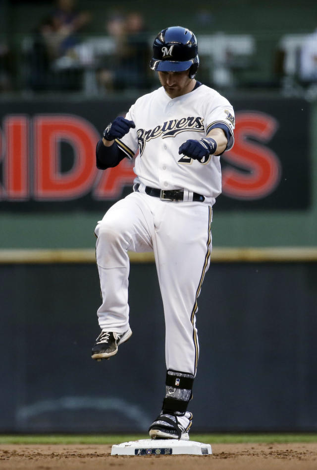Milwaukee Brewers' Jonathan Lucroy reacts after hitting an RBI double during the fourth inning of a baseball game against the Minnesota Twins, Monday, June 2, 2014, in Milwaukee. (AP Photo/Morry Gash)
