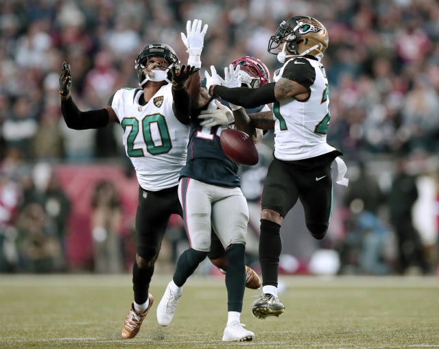 Jacksonville Jaguars cornerbacks Jalen Ramsey (20) and A.J. Bouye (21) break up a pass intended for New England Patriots wide receiver Brandin Cooks (14) during the second half of the AFC championship NFL football game, Sunday, Jan. 21, 2018, in Foxborough, Mass. (AP Photo/Charles Krupa)