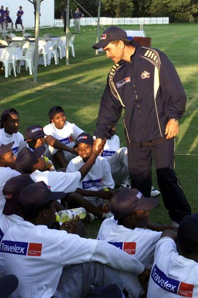 21 Feb 2002:  Justin Langer meets the participating children during an Australian Coaching Clinic for kids from the Alexandria Township at the Wanderers Club, Johannesburg. DIGITAL IMAGE. Touchline photo images are available to clients in UK, USA and Australia only. Mandatory Credit: Touchline Photo/Getty Images
