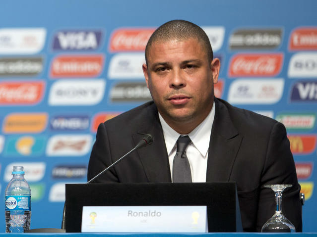FILE - In this Feb. 21, 2014 file photo, Ronaldo, Brazil's former soccer player and a member of the local organizing committee for the 2014 World Cup, attends a news conference during the Team Workshop for the 2014 World Cup at the Costao do Santinho hotel in Florianopolis, Brazil. In the latest chapter of a spat between past Brazil football greats, Ronaldo is publicly criticizing former teammate Romario for making another attack on him, this time over an alleged broken promise to provide free tickets for people with disabilities during the World Cup. (AP Photo/Andre Penner, File)