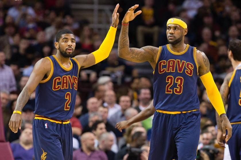 Cavaliers point guard Kyrie Irving (2) and forward LeBron James (23) celebrate after scoring against the Warriors in the first half Thursday night in Cleveland.