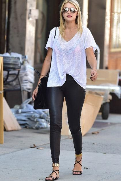 Even supermodels have lazy days. But leave it to Gigi to make leggings look über cool by pairing them with gold plated sandals and a sheer frayed tee.