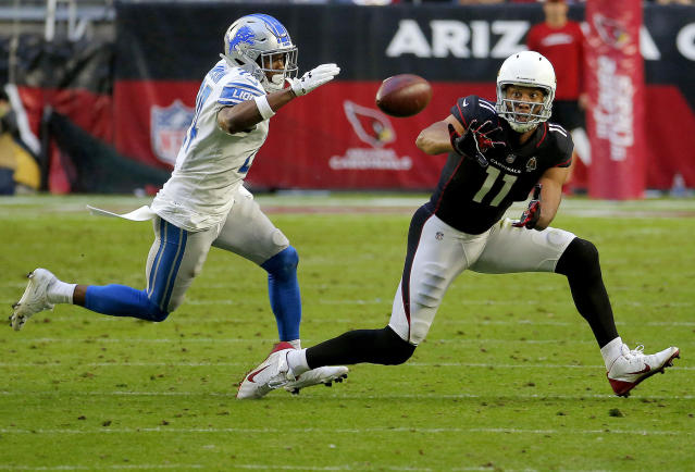 <p>Arizona Cardinals wide receiver Larry Fitzgerald (11) makes his 1,282nd career catch to surpass NFL Hall of Famer Jerry Rice for the most receptions with one team in NFL history during the second half of an NFL football game as Detroit Lions cornerback Nevin Lawson (24) defends, Sunday, Dec. 9, 2018, in Glendale, Ariz. (AP Photo/Rick Scuteri) </p>