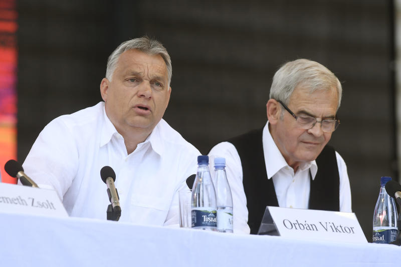 Hungarian Prime Minister Viktor Orban, left, speaks as President of the Hungarian National Council of Transylvania Laszlo Tokes looks on at the 30th Balvanyos Summer University and Students' Camp in Baile Tusnad, Transylvania, Romania, Saturday, July 27, 2019. (Szilard Koszticsak/MTI via AP)