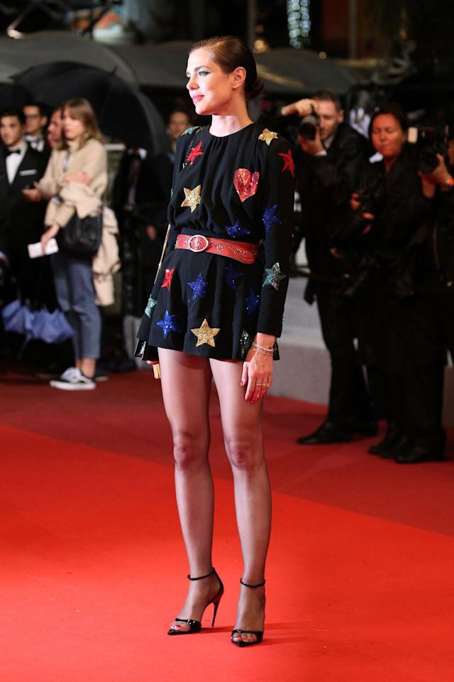 <p>Charlotte wore a whimsical romper to the Cannes Film Festival screening of <em>Lux Aeterna</em>. The romper featured sequined stars and hearts and a red belt. </p>