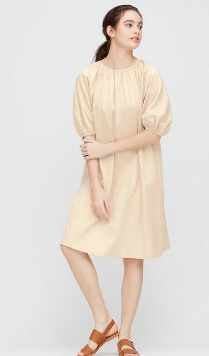 """Free shipping on all Uniqlo purchases through Monday, and a few <a href=""""https://www.uniqlo.com/us/en/women/limited-time-offers"""" rel=""""nofollow noopener"""" target=""""_blank"""" data-ylk=""""slk:really good promotions happening here"""" class=""""link rapid-noclick-resp"""">really good promotions happening here</a> too. <br> <br> <strong>Uniqlo</strong> Mercerized Cotton Gathered Sleeve Dress, $, available at <a href=""""https://go.skimresources.com/?id=30283X879131&url=https%3A%2F%2Fwww.uniqlo.com%2Fus%2Fen%2Fwomen-mercerized-cotton-gathered-3%252F4-sleeve-dress-426314.html%3Fdwvar_426314_color%3DCOL30%26cgid%3D%23q%3Ddress%26lang%3Ddefault%26start%3D18"""" rel=""""nofollow noopener"""" target=""""_blank"""" data-ylk=""""slk:Uniqlo"""" class=""""link rapid-noclick-resp"""">Uniqlo</a>"""