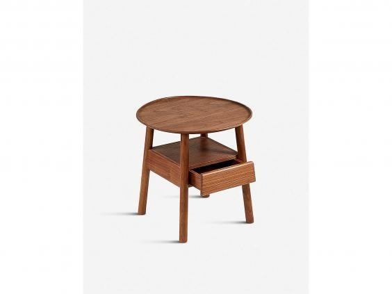 A wooden bedside table like this adds a stylish finishing touch (Selfridges)