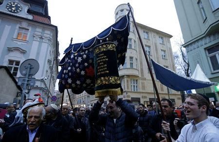 Members of the Czech Jewish Community dance with new Torah scrolls in front of the medieval Old-New Synagogue in Prague March 19, 2017.       REUTERS/David W Cerny