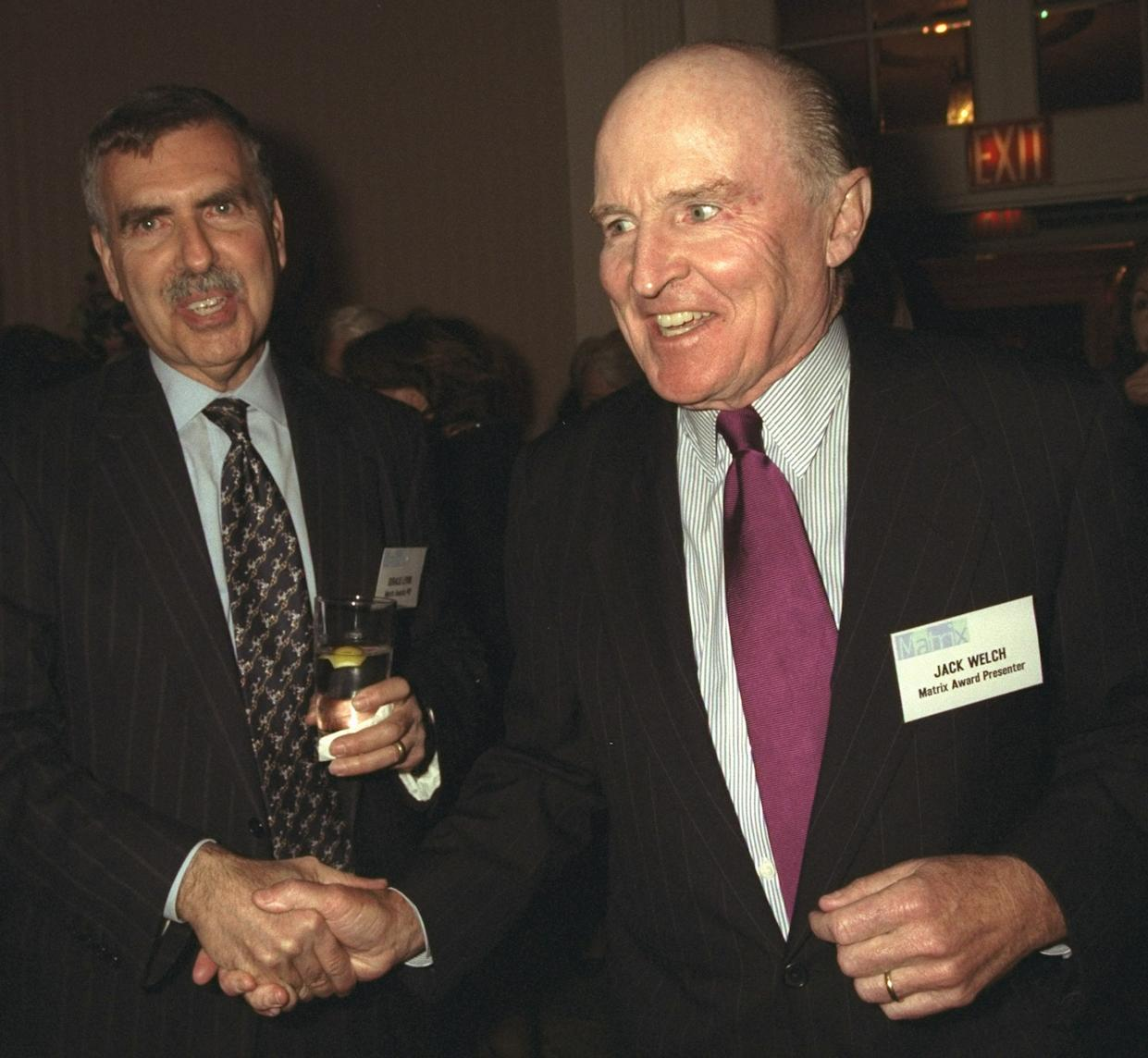 UNITED STATES - APRIL 19:  Time Warner chairman Gerald Levin (left) greets GE President Jack Welch at the New York Women in Communications 1999 Matrix Awards luncheon at the Waldorf-Astoria.  (Photo by Richard Corkery/NY Daily News Archive via Getty Images)