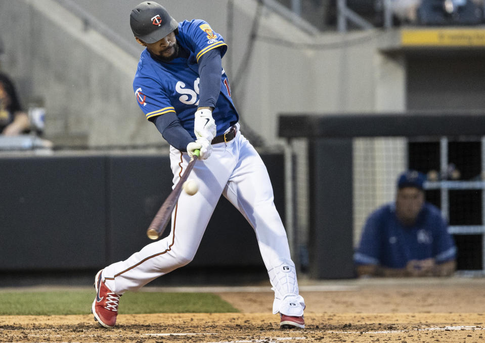 Minnesota Twins' Byron Buxton, playing for the St. Paul Saints, hits a triple in the sixth inning against the Omaha Storm Chasers in a minor league baseball game Tuesday, June 8, 2021, in St. Paul, Minn. Buxton is on a rehab assignment. (Jerry Holt/Star Tribune via AP)