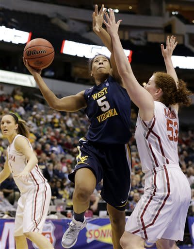 West Virginia' Averee Fields (5) goes up for a shot as Oklahoma's Joanna McFarland (53) defends in the first half of an NCAA college basketball game in the Big 12 women's tournament Saturday, March 9, 2013, in Dallas. (AP Photo/Tony Gutierrez)