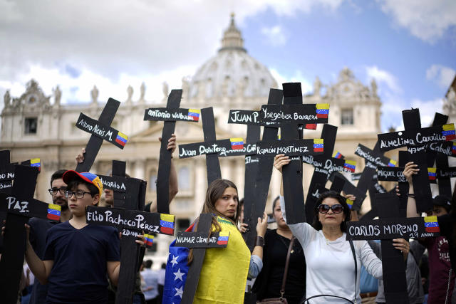 <p>Demonstrators hold black crosses with the names of those killed in weeks of violent demonstrations calling on Venezuela's President Nicolas Maduro to step down, in St. Peter's Square prior to the start of Pope Francis' noon prayer, at the Vatican, May 7, 2017. (Andrew Medichini/AP) </p>
